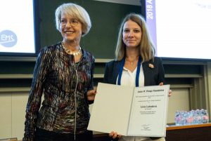 Lívia Labudová receiving the award certificate at EMS2018 from Tanja Cegnar.