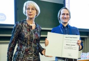 Mikhail Varentsov receiving the award certificate at EMS2018 from Tanja Cegnar.
