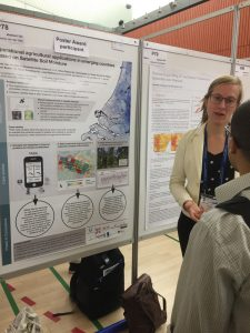 Mendy van der Vliet, winner of the EMS2019 Outstanding Poster Award, discussing her work with a conference participant (photo credit: EMS)