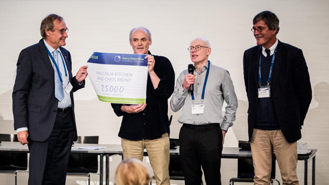 Chris Brund and Malcolm Kitchen receiving the Harry Otten Prize (from Harry Otten, left; together with Leo Kroon, chaor of the H.O.F.)